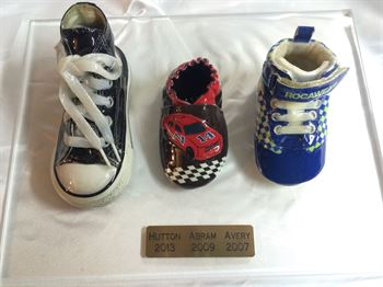 Picture of Style 6000 - 3 shoes on an acrylic base